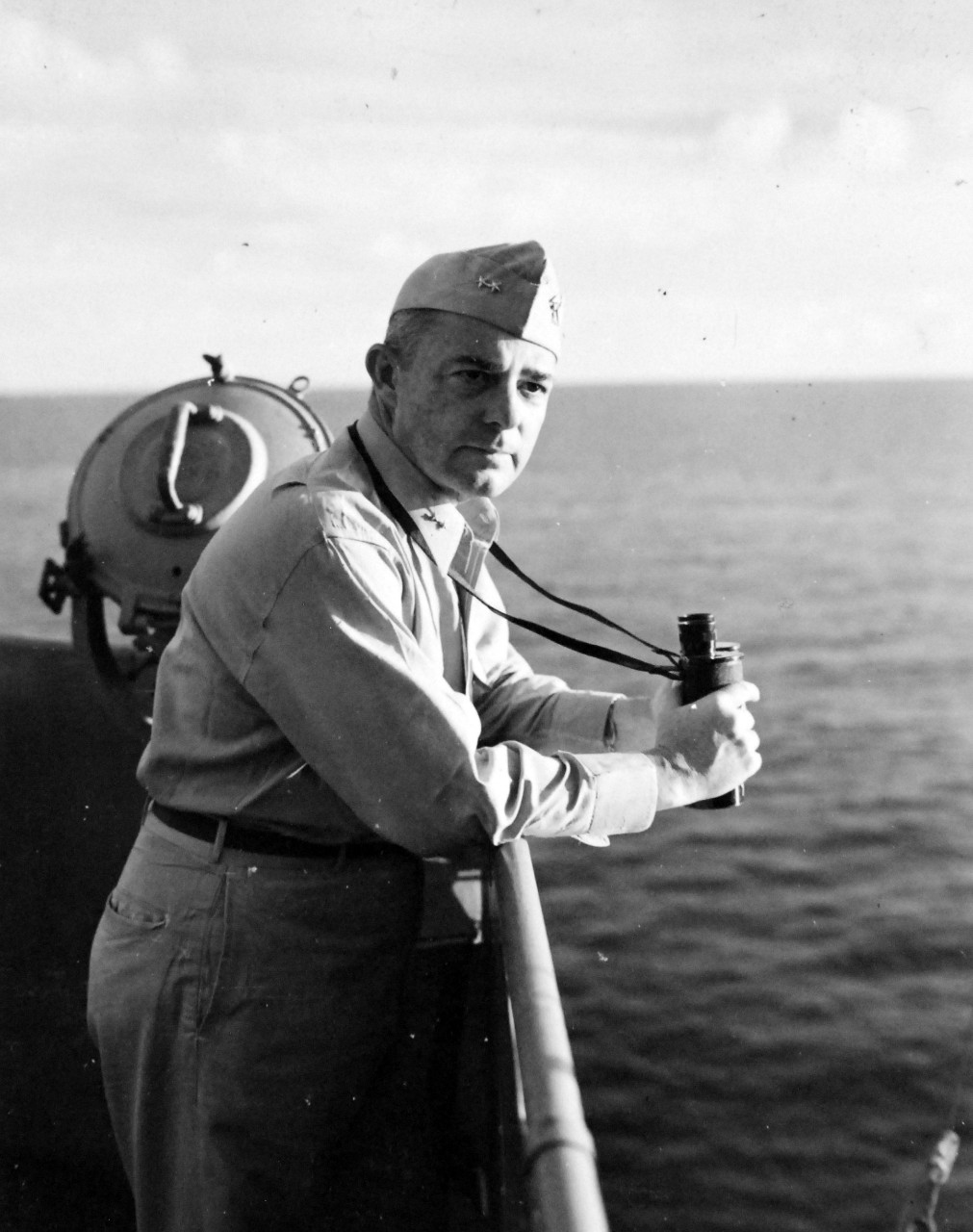 80-G-57537:  Battle of Cape Gloucester, New Britain, December 1943-January 1944.  Rear Admiral A.S. Merrill, Commander of Task Force 39 onboard USS Montpelier (CL-57), December 1943.  Official U.S. Navy Photograph, now in the collection of National Archives (2018/04/25).