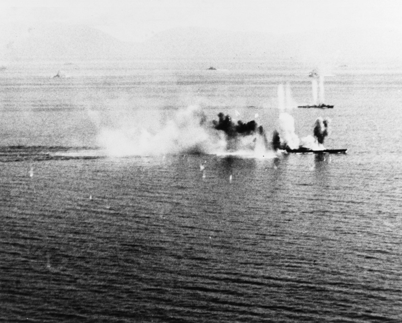 Japanese battleship Musashi under heavy attack during the Battle of the Sibuyan Sea, 24 October 1944.