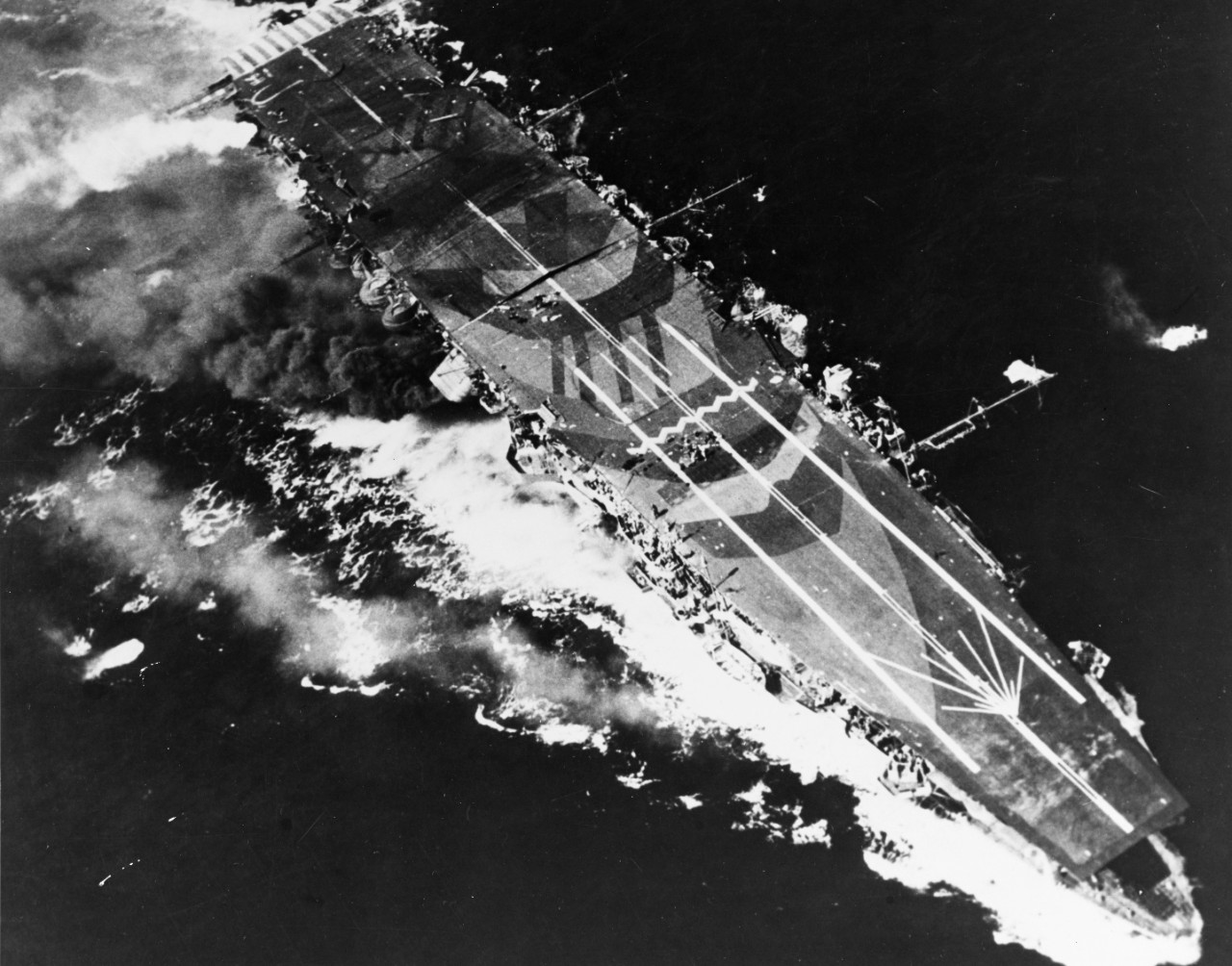 Japanese aircraft carrier Zuiho under attack by planes from USS Enterprise during the Battle off Cape Engano, 25 October 1944.