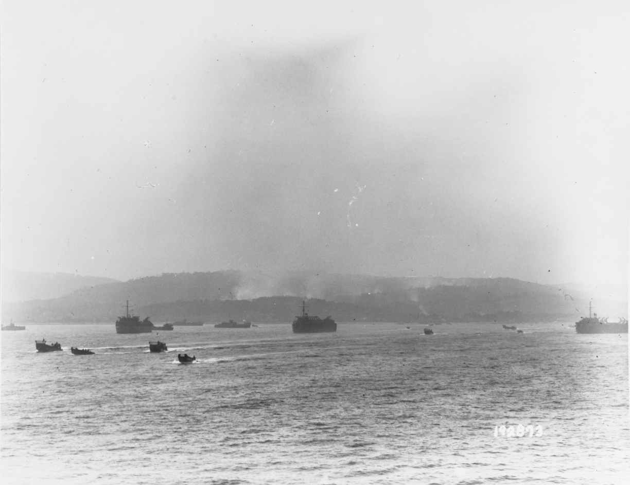 "Southern France Invasion, August 1944. LCVPs and LCMs pass LSTs while retracting from ""Alpha Yellow"" Beach on ""D-Day"""