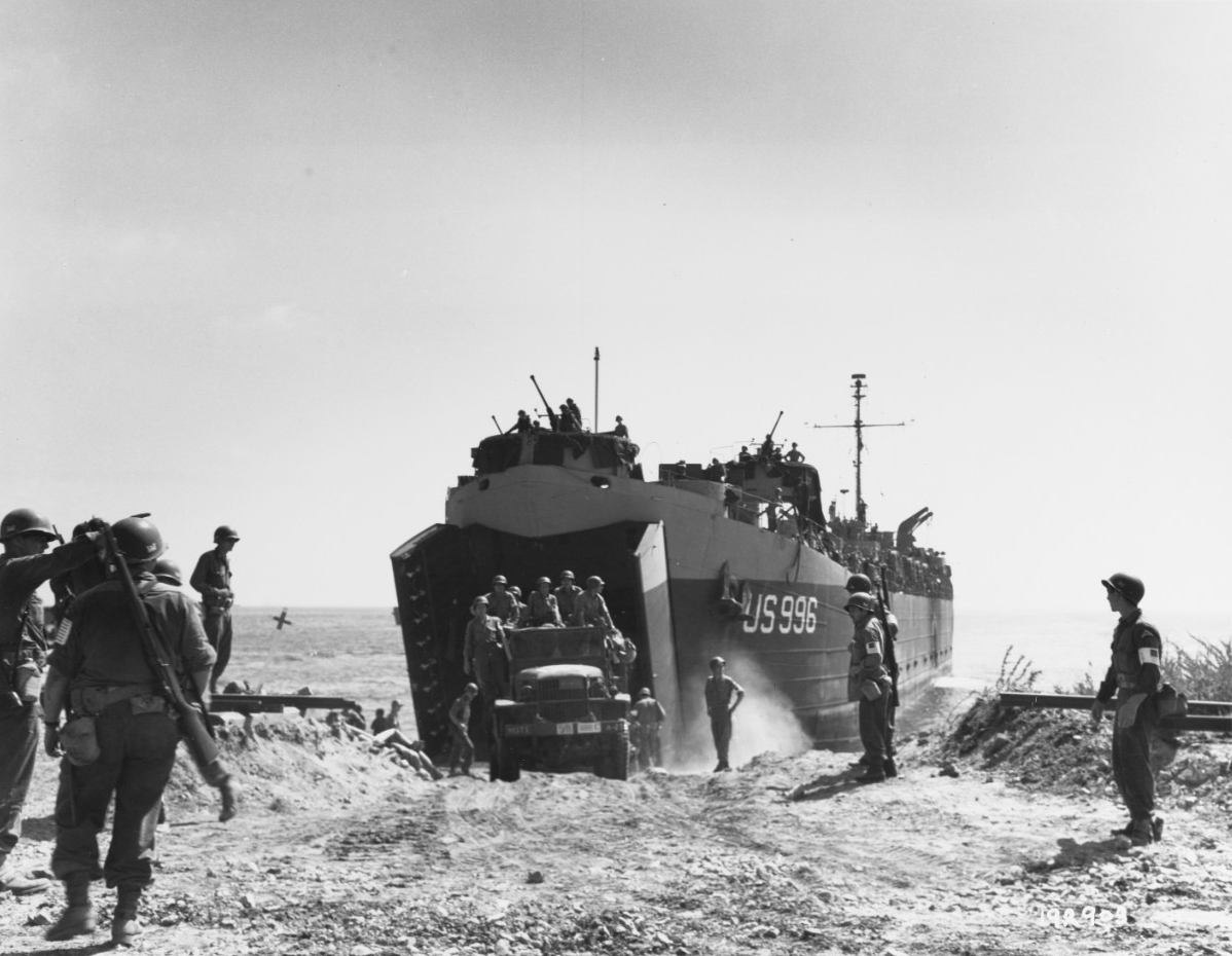 Southern France Invasion, August 1944. An Army truck drives ashore from USS LST-996, the first LST to reach the beach
