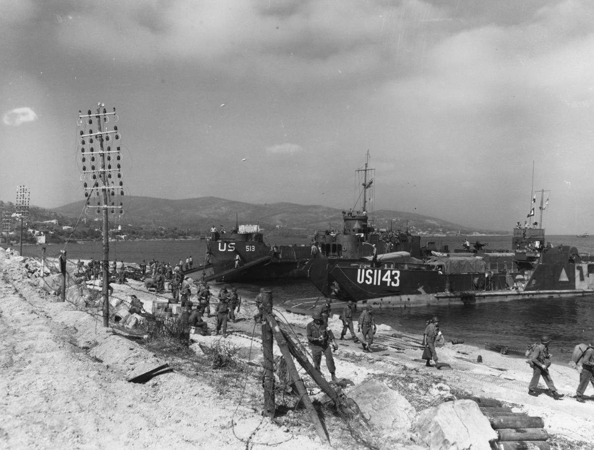 "Southern France Invasion, August 1944. USS LCI-513 and LCT-1143 unloading on a Southern France beach, on ""D-Day"""