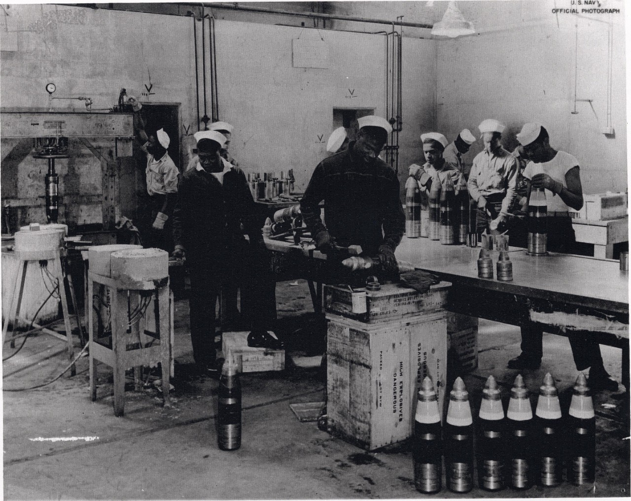 <p>African American sailors of an ordnance battalion preparing 5-inch shells for packing, Port Chicago Naval Magazine, circa 1943/44.</p>