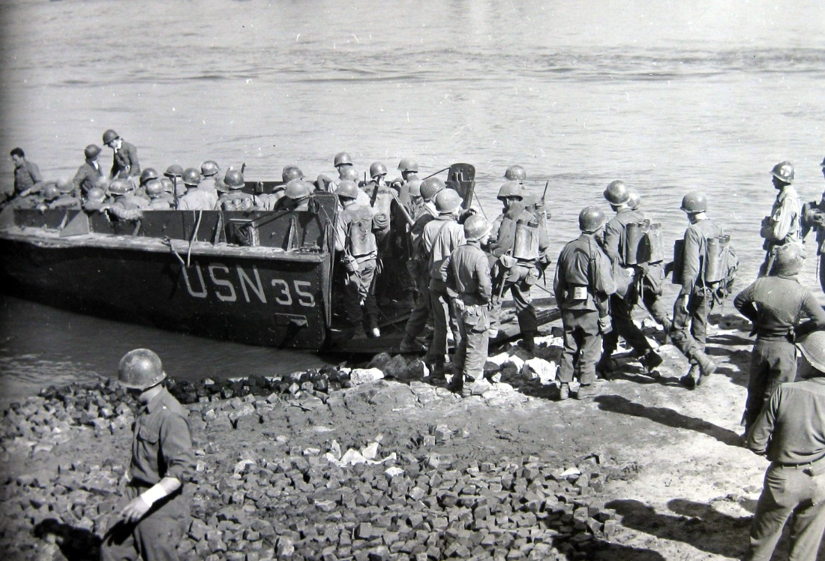 <p>Advancing into Germany, U.S. Third Army infantrymen board a LCVP to cross the Rhine.</p>