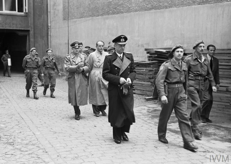 <p>Grossadmiral Karl Doenitz is arrested in Flensburg, Germany, on 23 May 1945 by personnel of the RAF Regiment. Armaments Minister Albert Speer and Armed Forces&nbsp;Chief of&nbsp;Operations Generaloberst Alfred Jodl follow Doenitz as they are led away by armed guards.&nbsp;&nbsp;</p>
