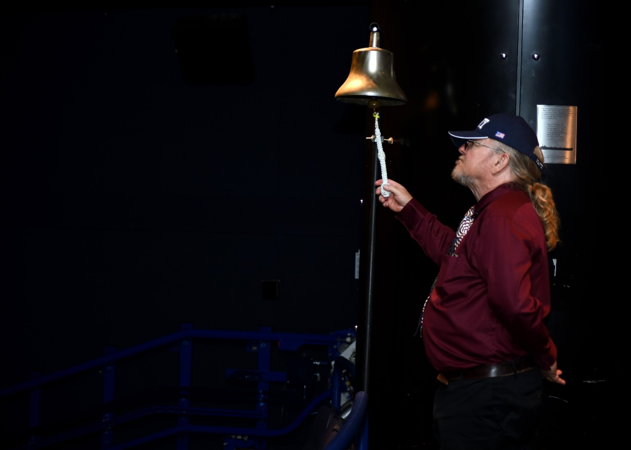 Michael Davis rings a bell at the Navy Memorial