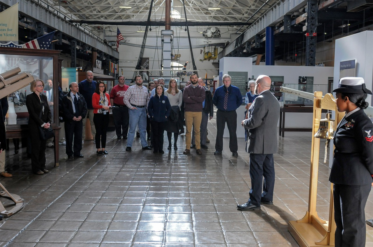 181108-N-GK939-0042 WASHINGTON (NNS) (Nov. 8, 2018) Guests gather for a Bell Ringing ceremony for the USS San Diego exhibit at the National Museum of the U.S. Navy.