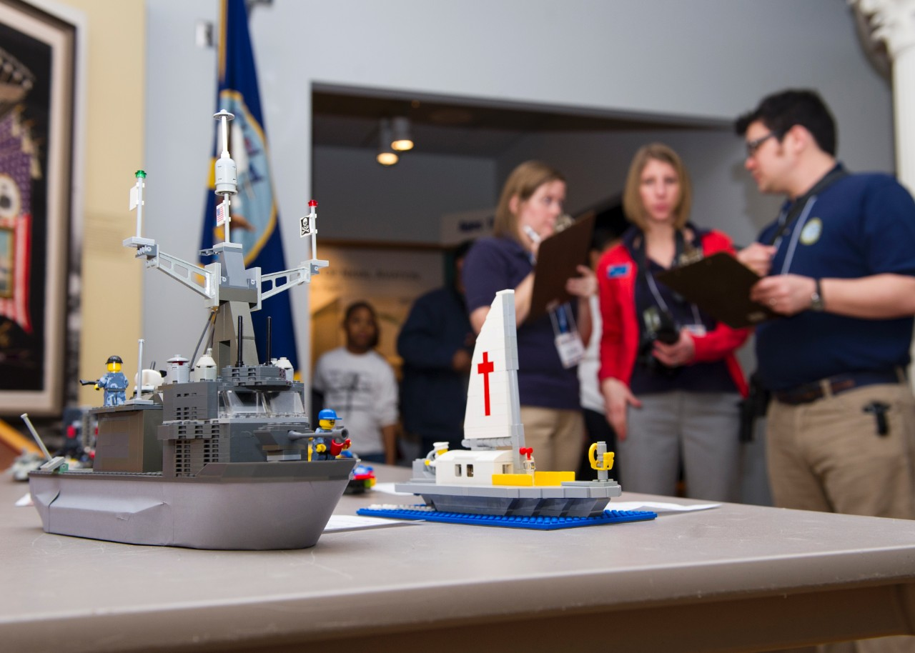 Judges examine an entry during the Brick-by-Brick Lego Shipbuilding Competition at the Hampton Roads Naval Museum.
