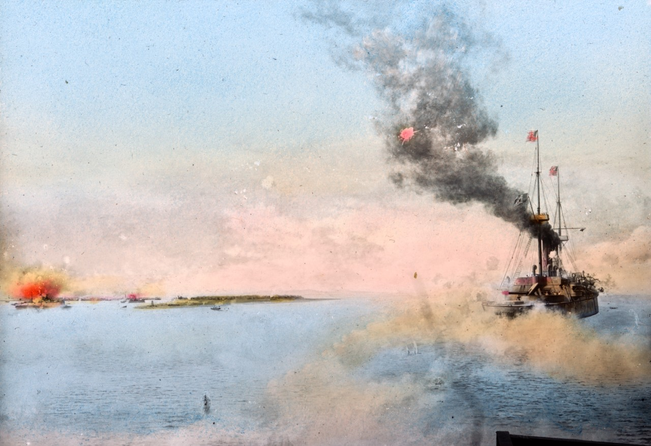 An undated colorized photo shows the protected cruiser USS Boston during the Spanish-American War.