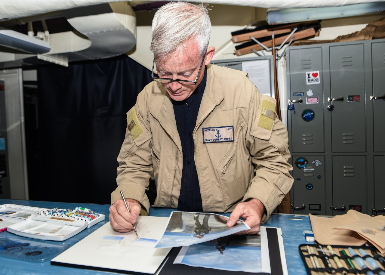 Kristopher Battles, navy combat artist for Navy History and Heritage Command (NHHC) paints