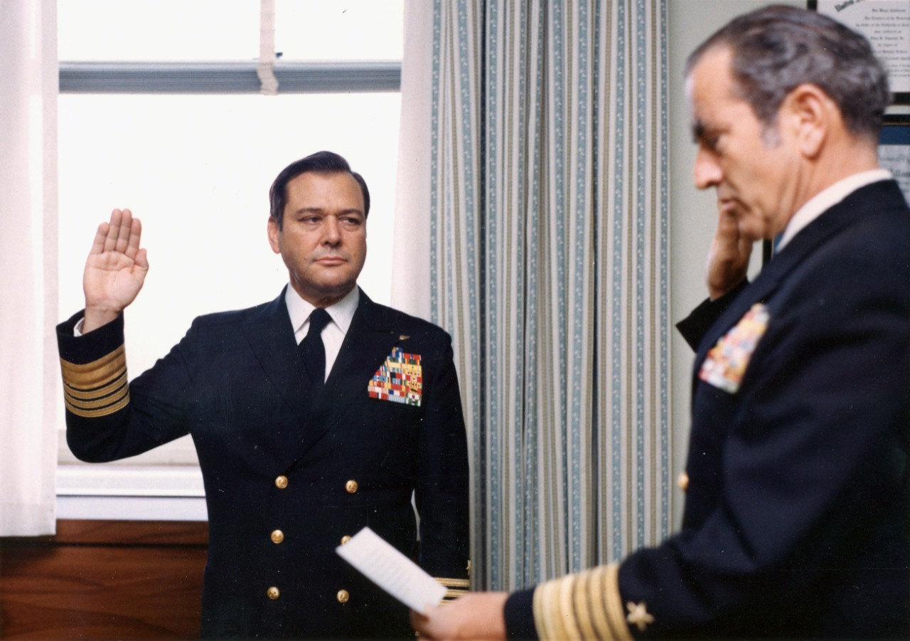 8 color and black and white images from the career of Admiral Admiral James L. Holloway III, USN. Shown: swearing in as VCNO by Admiral Elmo Zumwalt; laughing with USSR Admiral of the Fleet Nikolai Ivanovich Smirnov in 1978; as a Rear Admiral with Admiral Hyman Rickover and Admiral Thomas Moorer; visitors to USS Enterprise (CVAN-65) in 1966 at Pearl Harbor after first combat cruise, with USS Kawishiwi (T-AO-146) in background; underway replenishment of USS Enterprise, bombs coming on board; pilots of Bombing Squadron Three (VB-3) in 1947 on the deck of an unidentified aircraft carrier; Holloway as a Midshipman; posing in civilian attire with unidentified Japanese individuals including women in geisha attire.