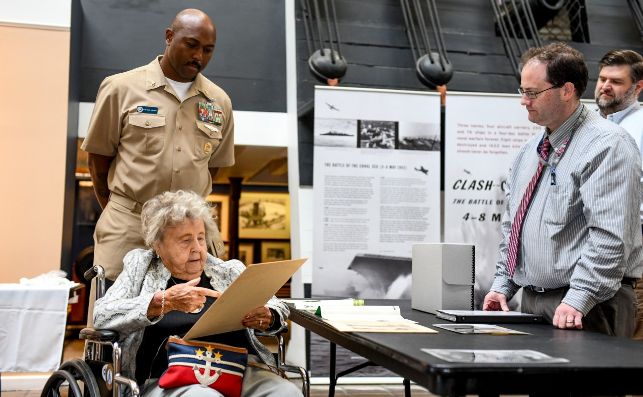 "<p>WASHINGTON NAVY YARD (Sept. 20, 2019) Ima Black, widow of the Navy's first Master Chief Petty Officer of the Navy (MCPON), describes at a photo of her late husband MCPON Delbert Black to Master Chief Yeoman Nathaniel Colding, senior enlisted leader of Naval History and Heritage Command (NHHC) and Glenn Gray, NHHC Archives division deputy director, during a tour of the National Museum of the United States Navy. Black enlisted in the Navy under the Women Accepted for Volunteer Emergency Service (WAVES) during WWII as a seaman first class storekeeper. The WAVES performed jobs in fields such as aviation, clerical, medical, communication, legal, intelligence, and science and technology. On June 12, 1948, President Harry Truman signed Public Law 625, the ""Women's Armed Services Integration Act"", which approved regular and Reserve component status for women in the military and disbanded the WAVES. (U.S. Navy photo by Mass Communication Specialist 2nd Class Mutis A. Capizzi/RELEASED)</p>"