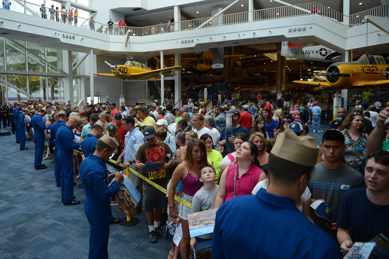 The Blue Angels, sign autographs at the National Naval Aviation Museum at Naval Air Station Pensacola