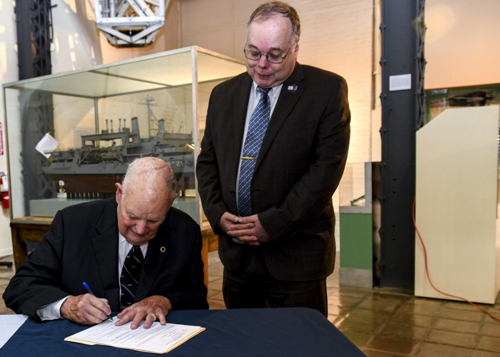 "<p>WASHINGTON NAVY YARD (Oct. 15, 2019) Retired Rear Adm. Robert Fountain signs a document granting four artifacts from USS Scorpion (SSN 589) to Naval History and Heritage Command (NHHC) as witnessed by retired Rear Adm. Samuel Cox, director of NHHC. Fountain, former executive officer of the submarine, received the artifacts from the Scorpion crew in 1968 on his departure from the submarine; six months before the sub was declared ""presumed lost."" NHHC, located at the Washington Navy Yard, is responsible for the preservation, analysis, and dissemination of U.S. naval history and heritage. (U.S. Navy photo by Mass Communication Specialist 2nd Class (SW/AW) Mutis A. Capizzi/Released)</p><p>&nbsp;</p>"