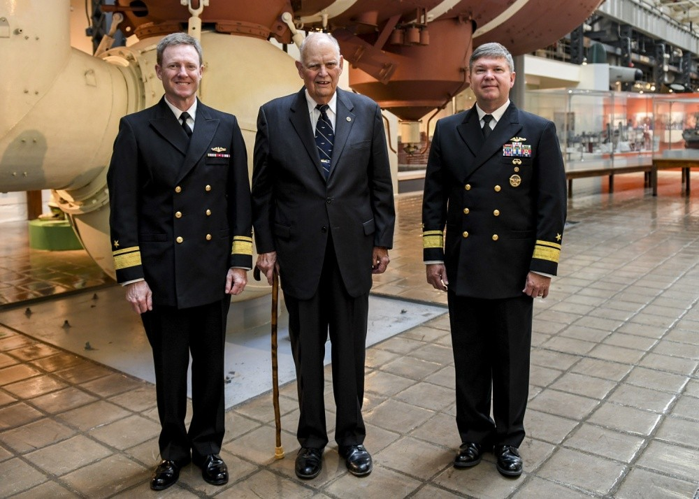 "<p>WASHINGTON NAVY YARD (Oct. 15, 2019) (Pictured from left to right) Rear Adm. Andrew Lennon, vice director, Navy Staff, Office of the Chief of Naval Operations; retired Rear Adm. Robert Fountain, former executive officer USS Scorpion (SSN 589); and Rear Admiral Thomas Ishee, director, Undersea Warfare Division Office of the Chief of Naval Operations, pose for a photo at the National Museum of the U.S. Navy Oct 15, following a donation ceremony. Naval History and Heritage Command held the ceremony to unveil four artifacts from Scorpion donated by Fountain. Fountain received the artifacts from the crew in 1968 on his departure from Scorpion; six months before the submarine was declared ""presumed lost."" NHHC is located at the Washington Navy Yard and is responsible for the preservation, analysis, and dissemination of U.S. naval history and heritage. (U.S. Navy photo by Mass Communication Specialist 2nd Class (SW/AW) Mutis A. Capizzi/Released)</p>"
