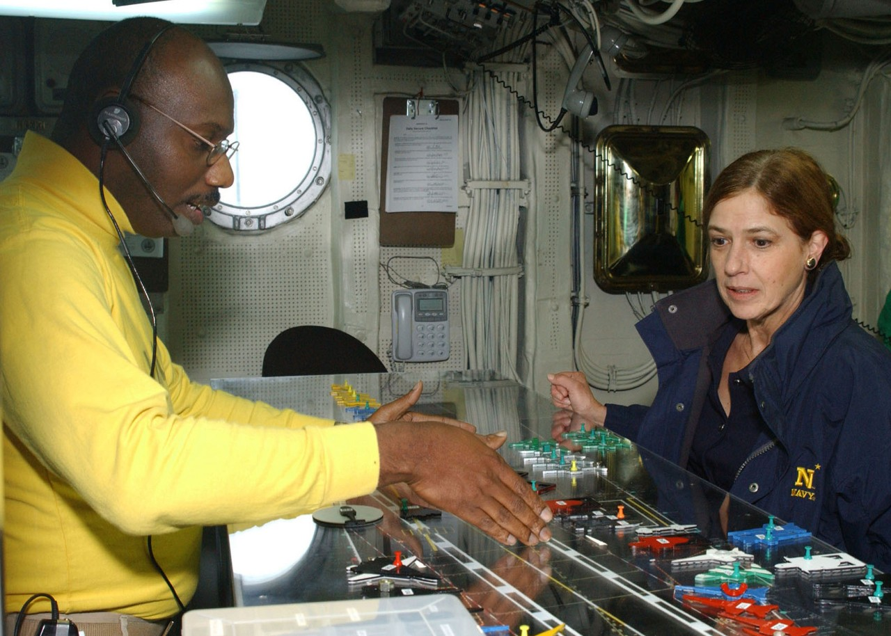 Lt. Cdr. Donald Griffin explains to the Honorable Ms. Susan Morrisey Livingstone, Under Secretary of the Navy, what the job of being Roosevelt's 'Handler' involves. The Roosevelt is underway conducting Tailored Ship Training Availability (TSTA). U.S. Navy photo by Photographers Mate Airman Todd Flint. (RELEASED)