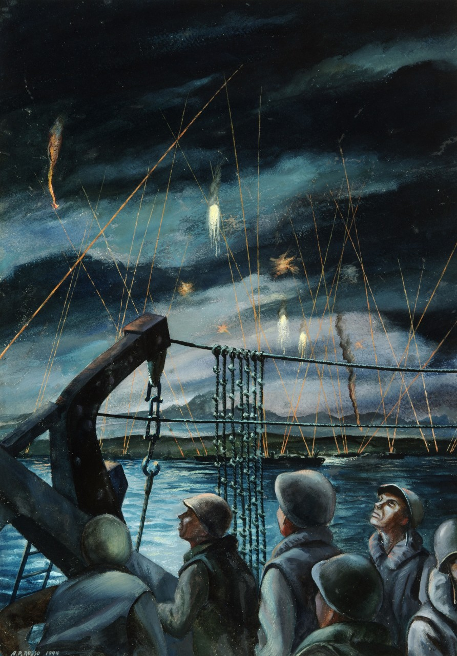 Men on a landing craft watch flares in the night sky