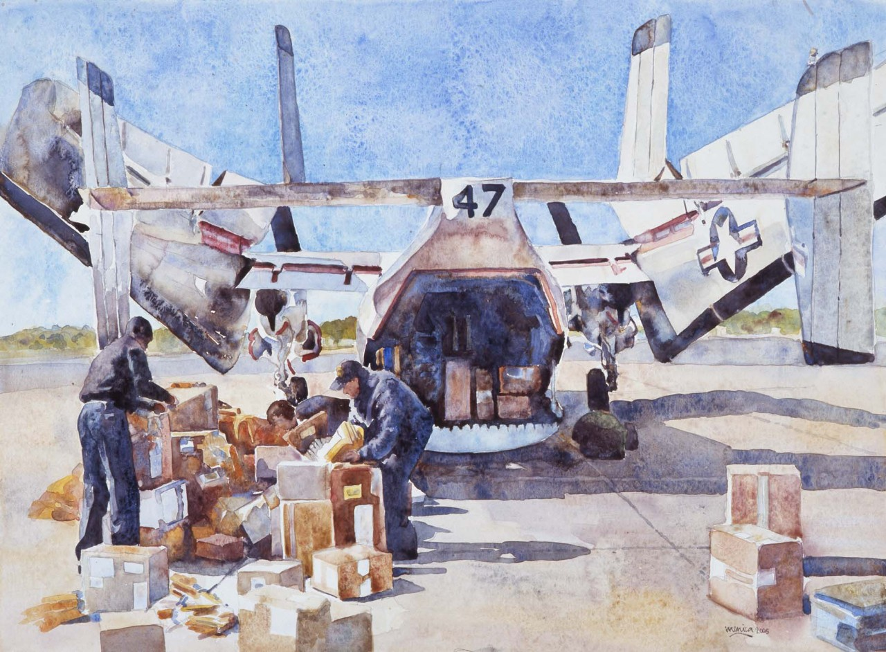 Two sailors preparing mail for transport by airplane