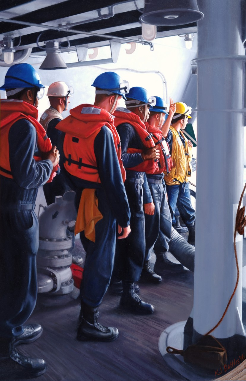 A group of enlisted sailors wearing life jackets and helmets wait at a hatch for the signal to go on deck