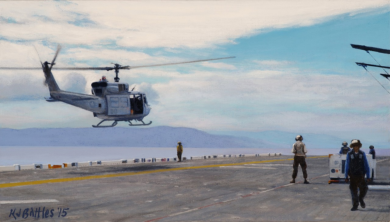 A helicopter coming in for a landing on a flight deck