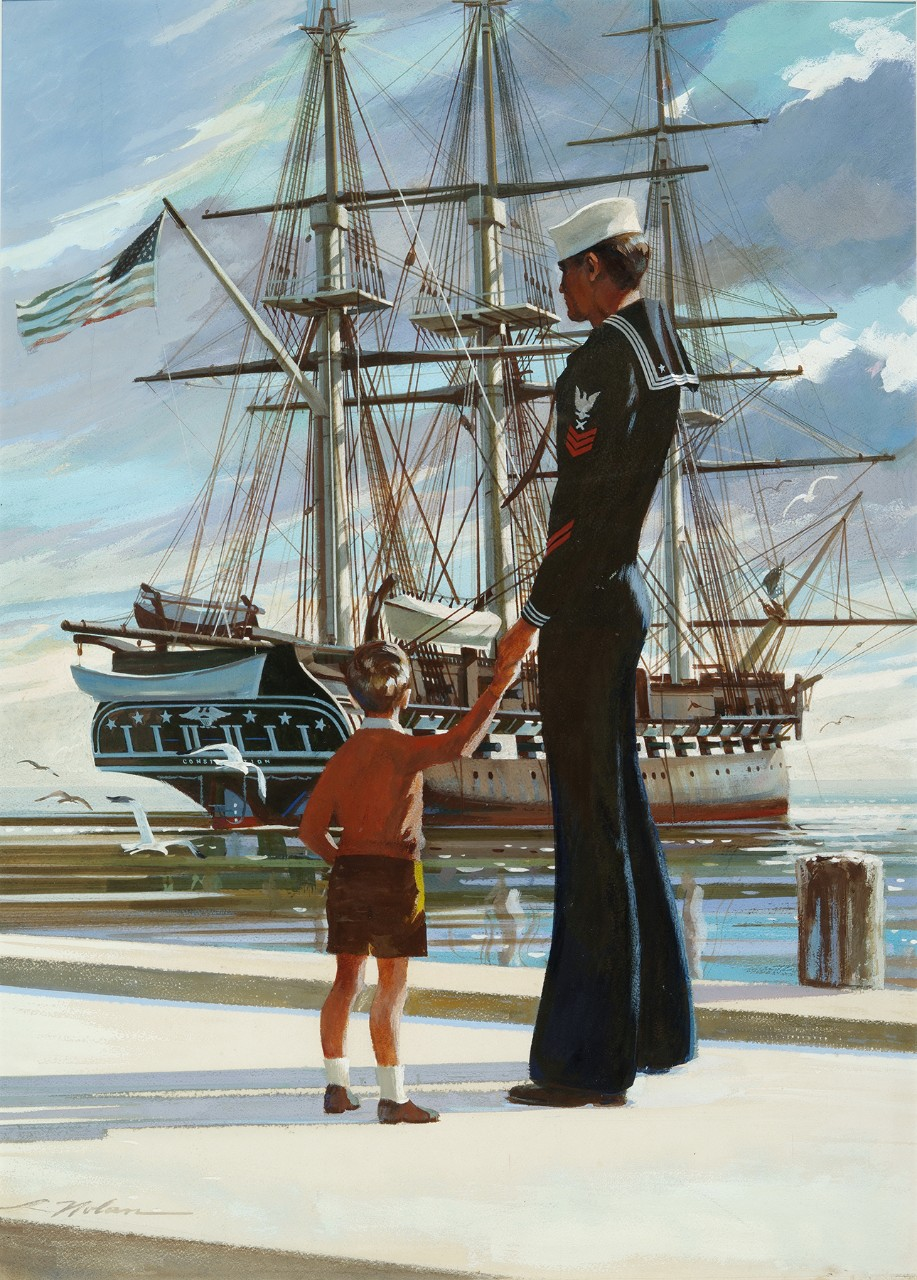A sailor holds the hand of a little boy while both look at USS Constitution