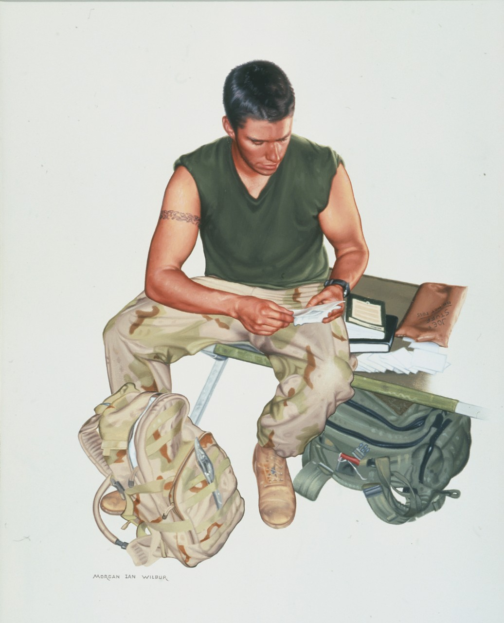 A navy corpsman sits on a cot reading a letter
