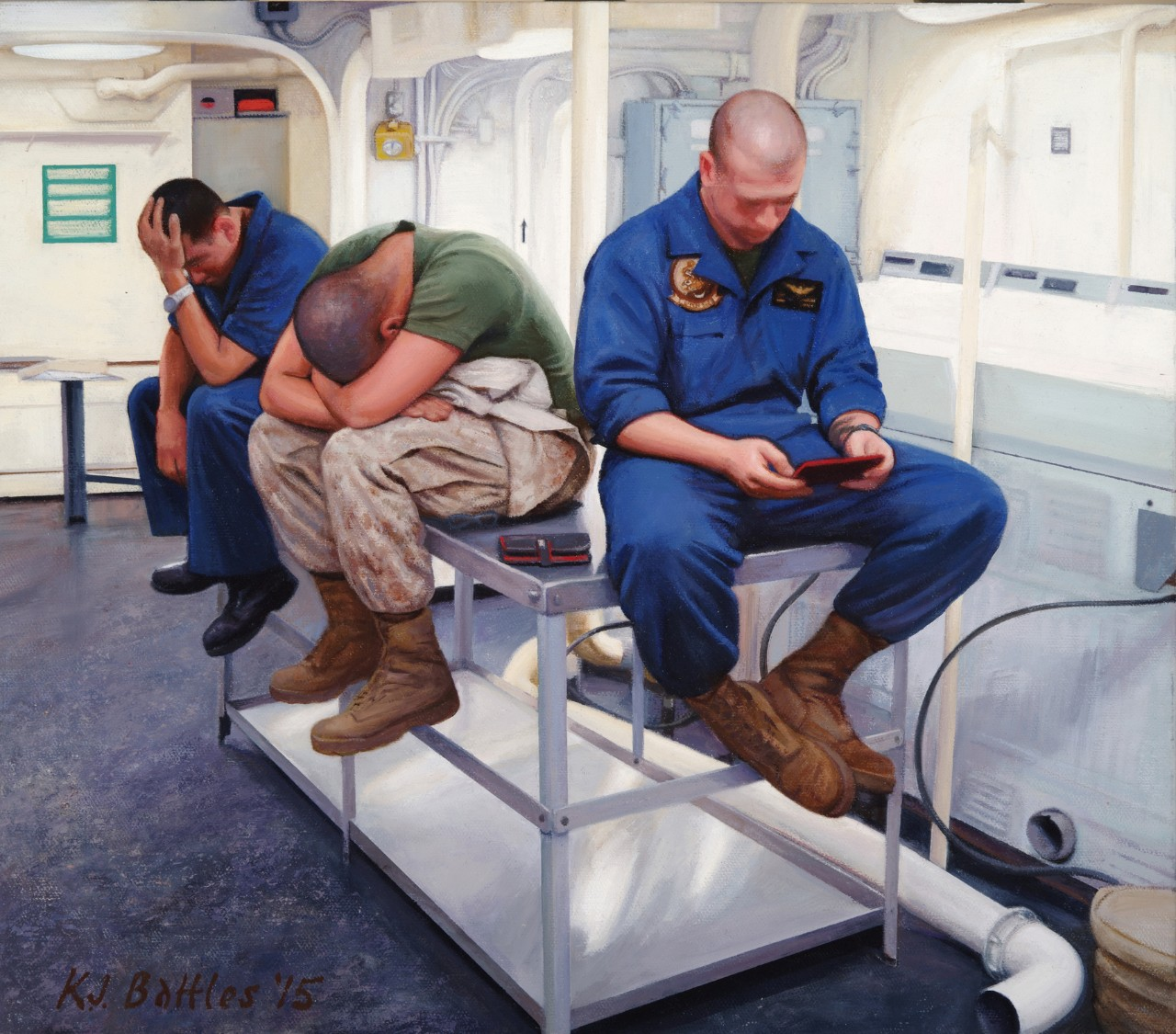 Three crewmen sit on a table in the laundry room looking bored
