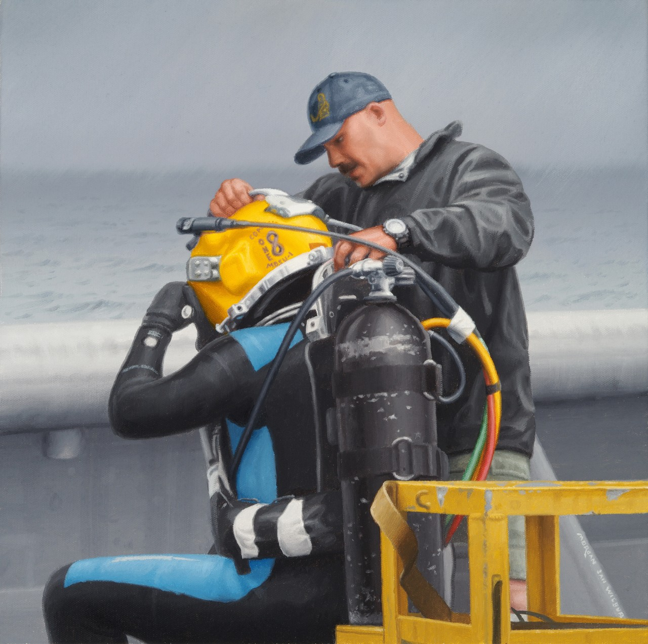 A man in a ball cap and a jacket is helping a diver with his gear