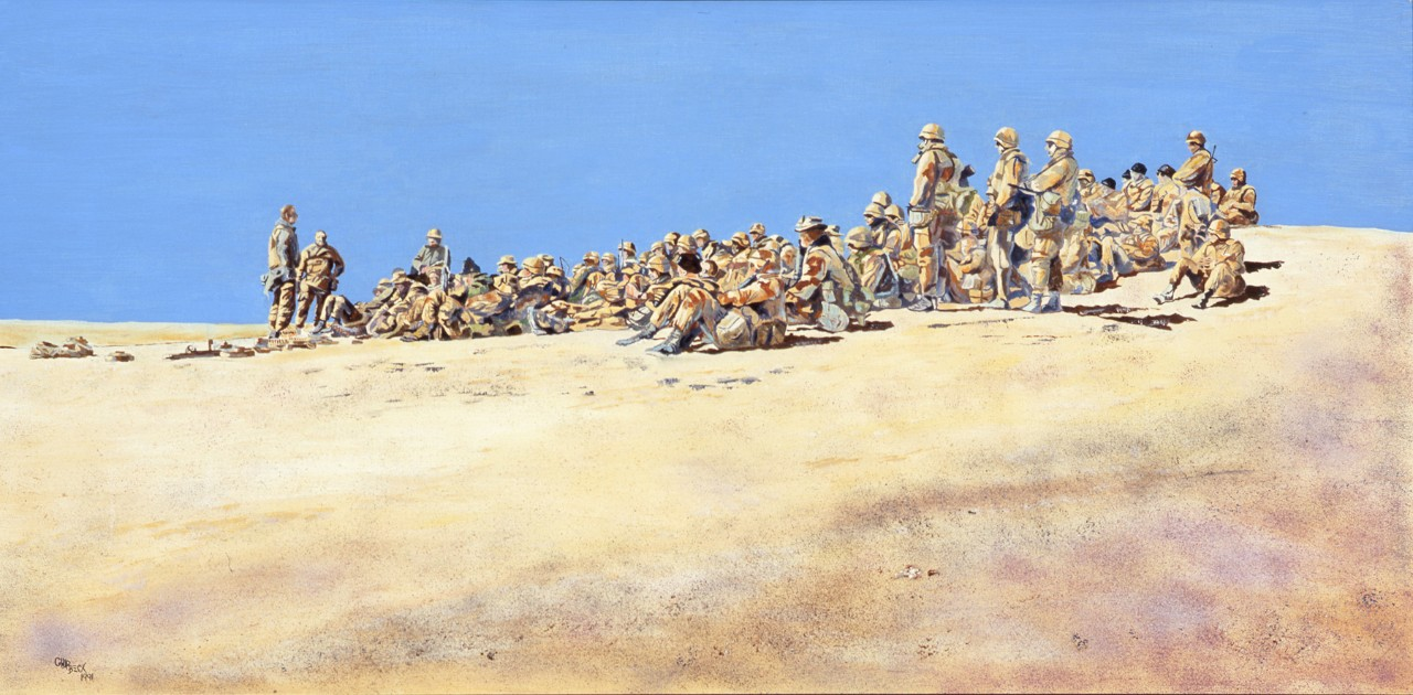 A group of Marines are seated on a hill side