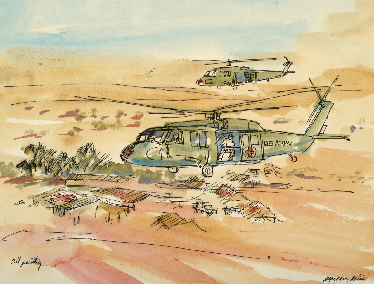 Two helicopters fly over hospital tents in the desert