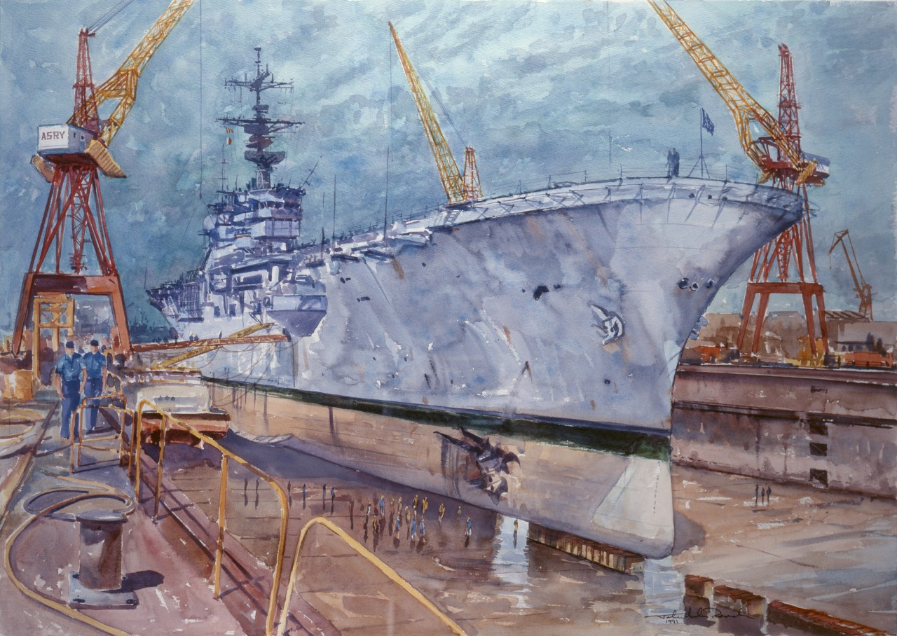 An amphibious assault ship in a dry dock being serviced