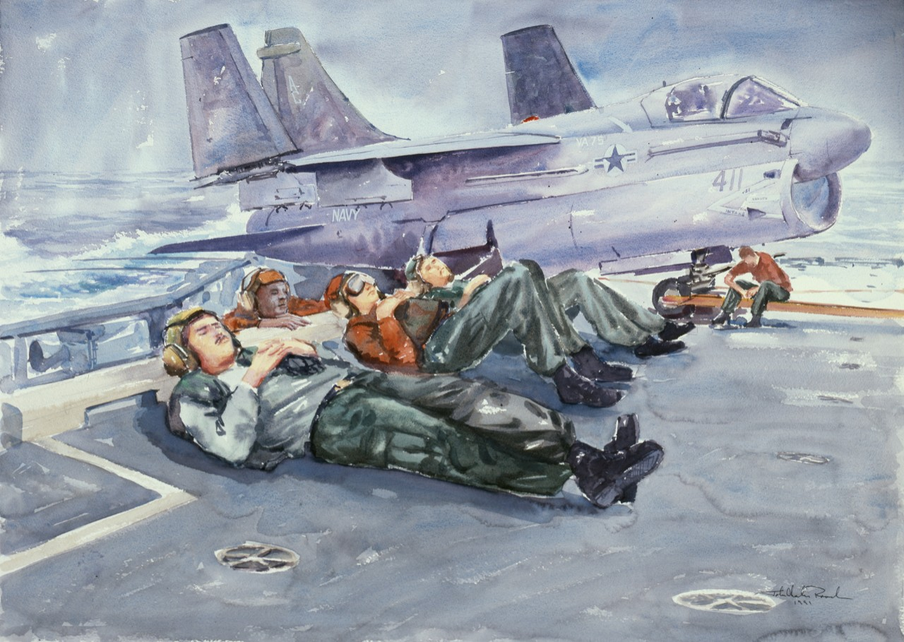 Four crewmen rest on the deck, with an airplane in the background