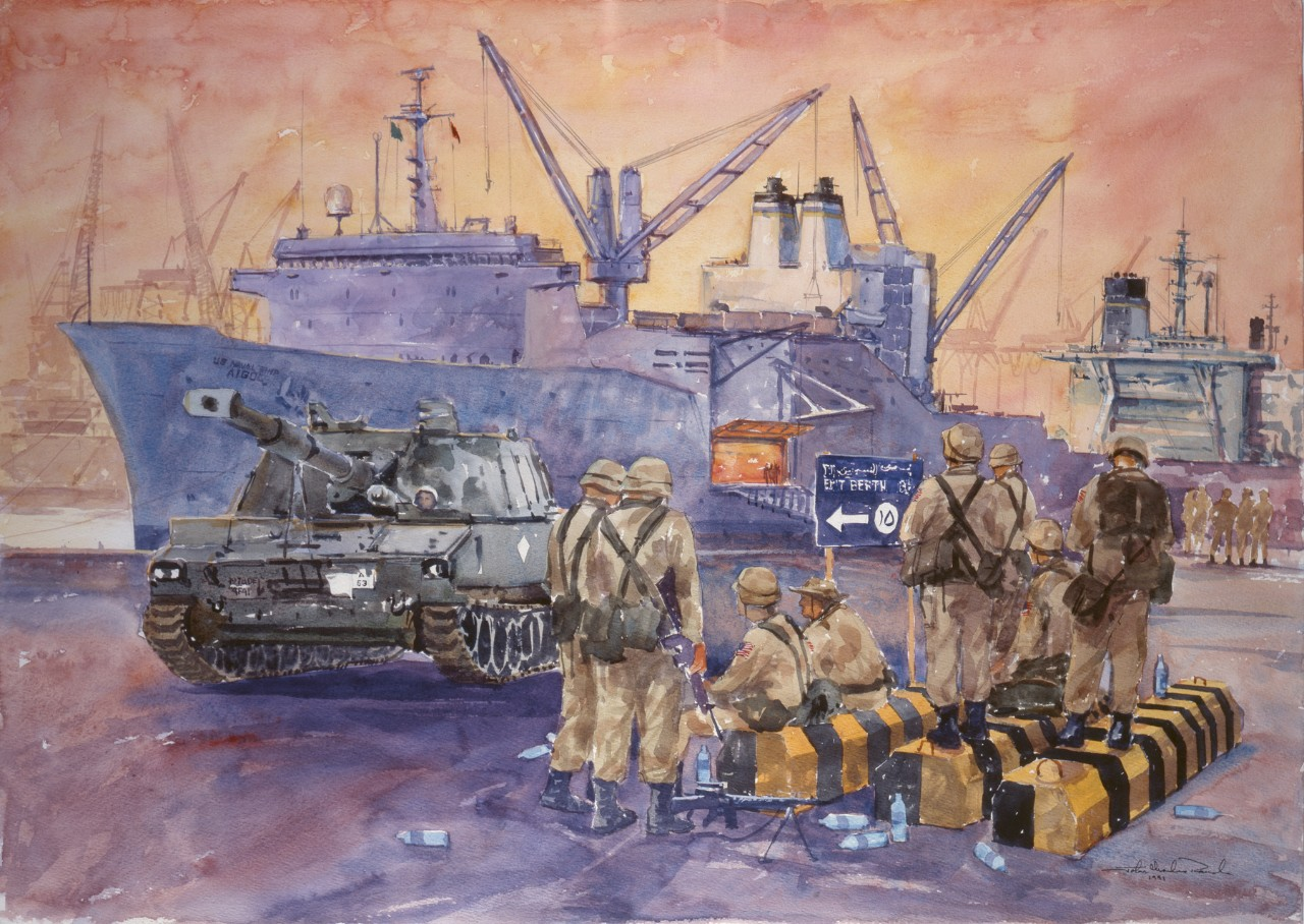 A group of Marines relax on the pier as a tank is recently unloaded from a transport in the background