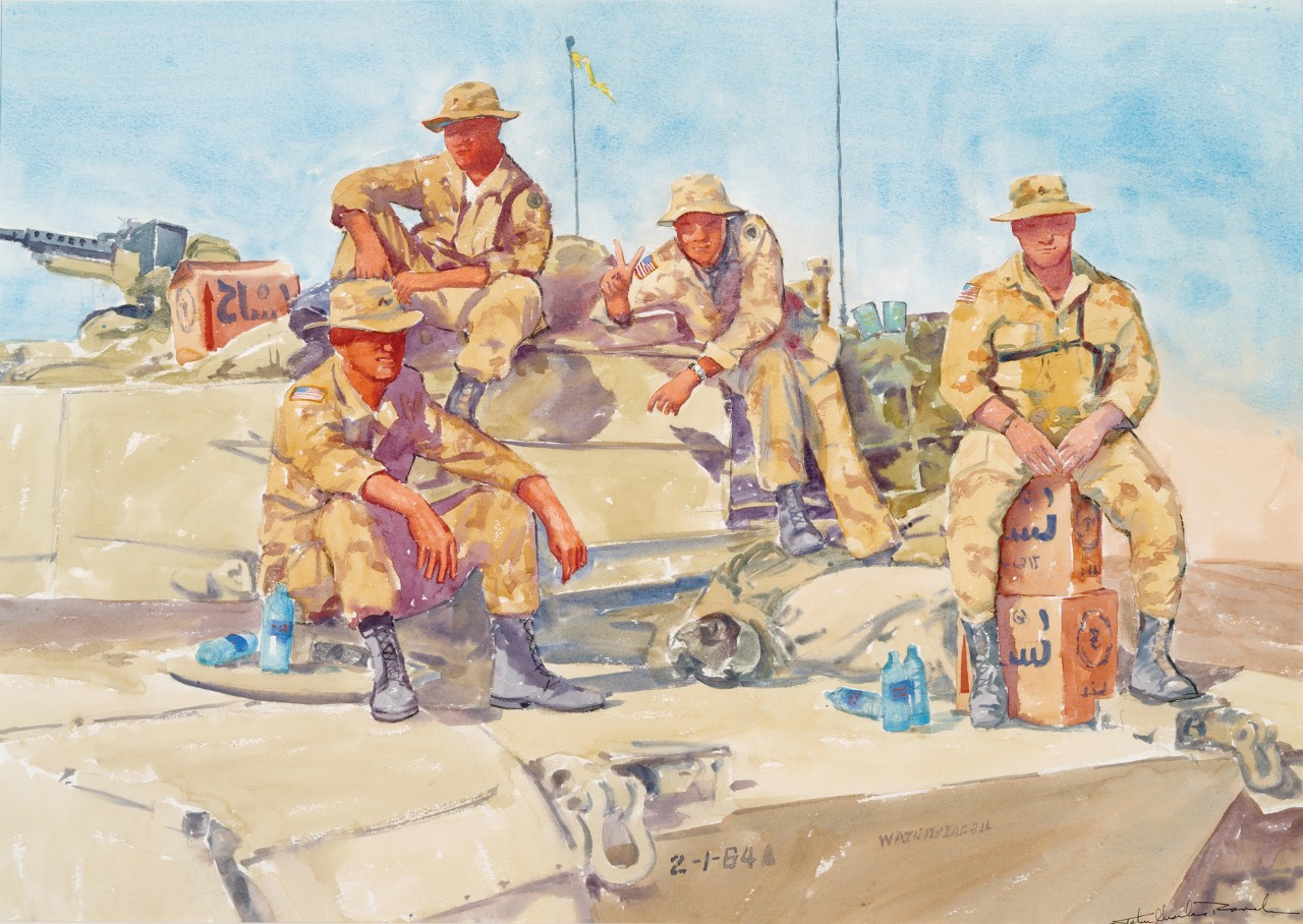 Four marines sitting on top of a tank
