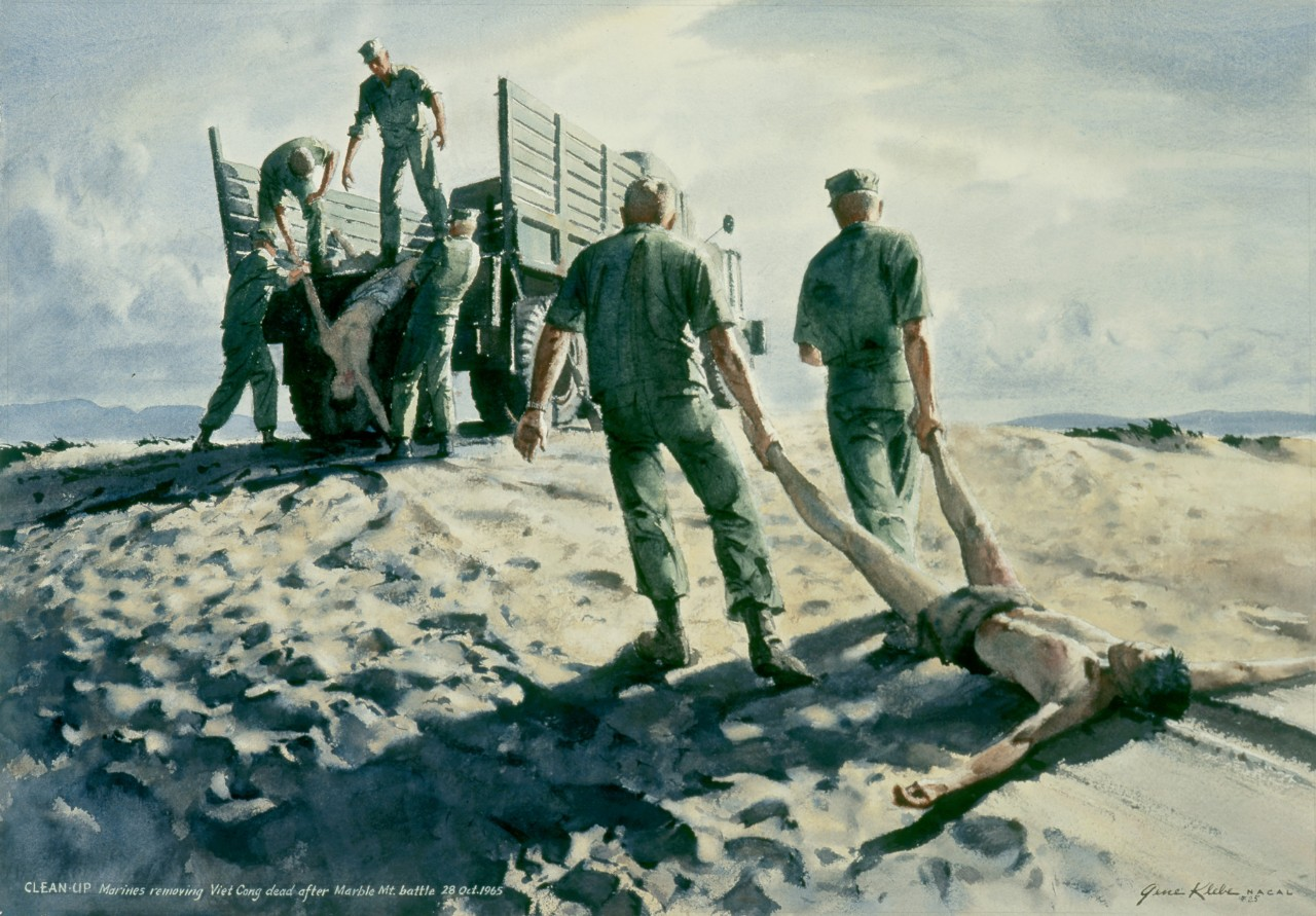 Marines gather the Viet Cong dead