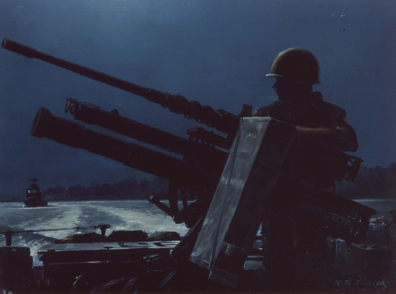 A gunner on a river patrol boat at night