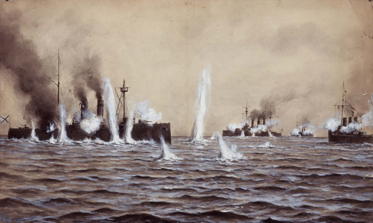 A ship on the left side is being shelled there are three other ships in the background
