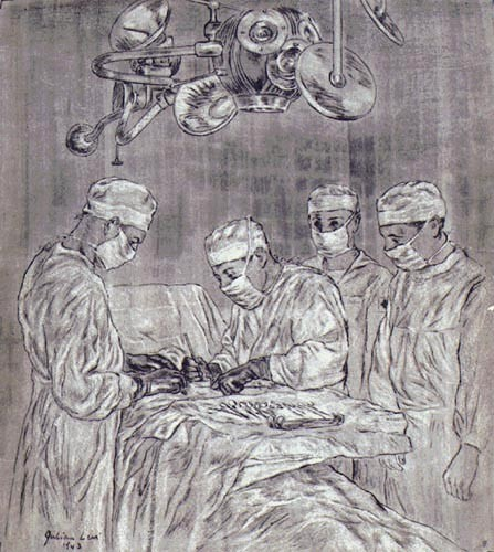 Two surgeons and two assistants performing surgery on a man