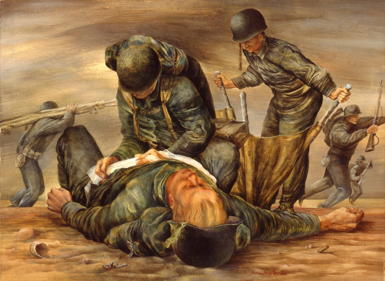 Two navy corpsmen treat causality on the beach
