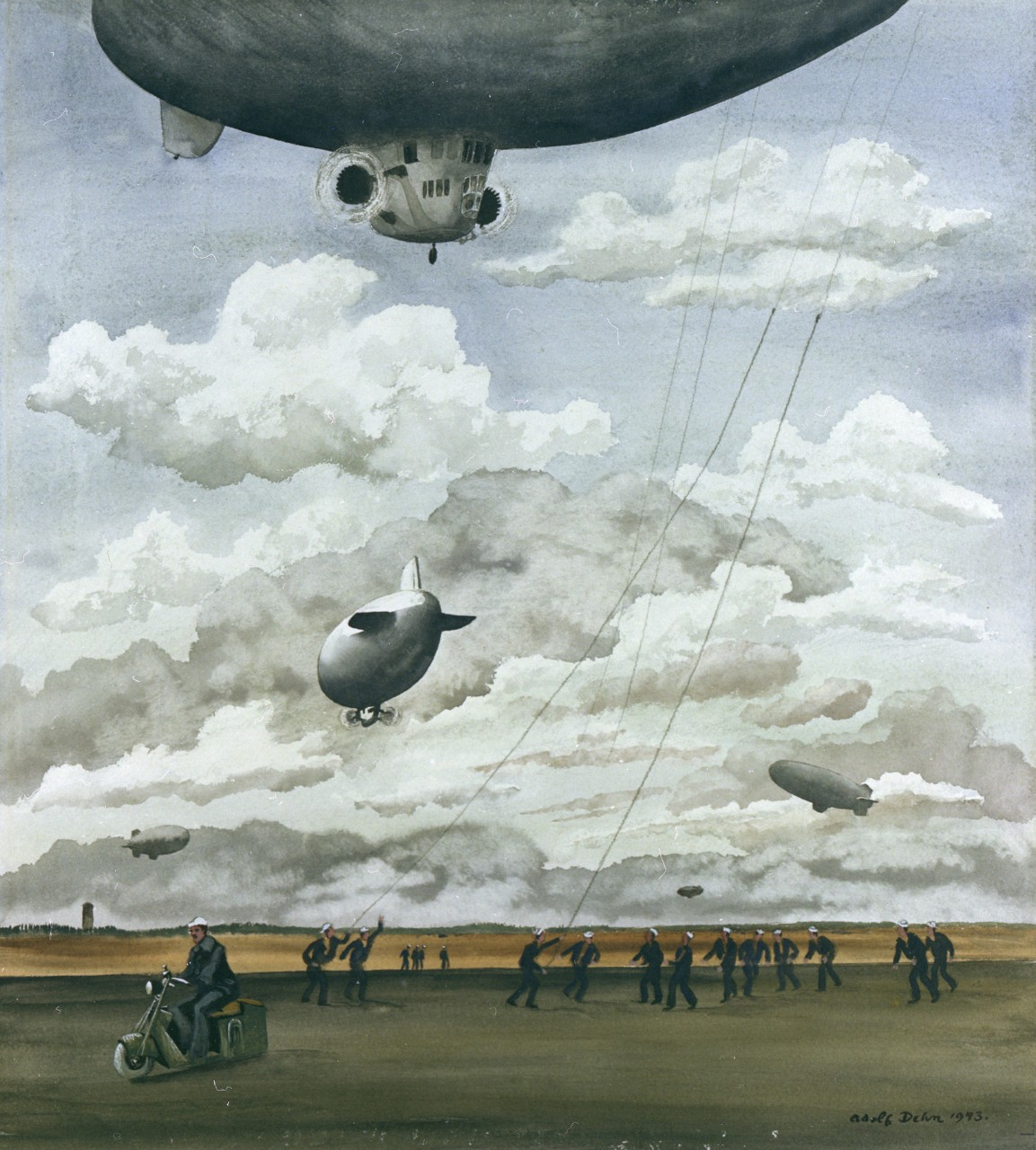 A ground crew grabs the lines from the blimp