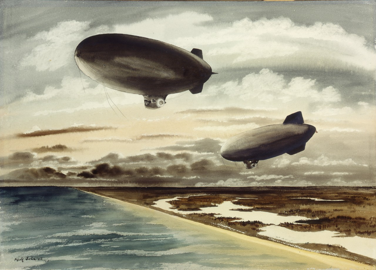 Two blimps flying over the coast