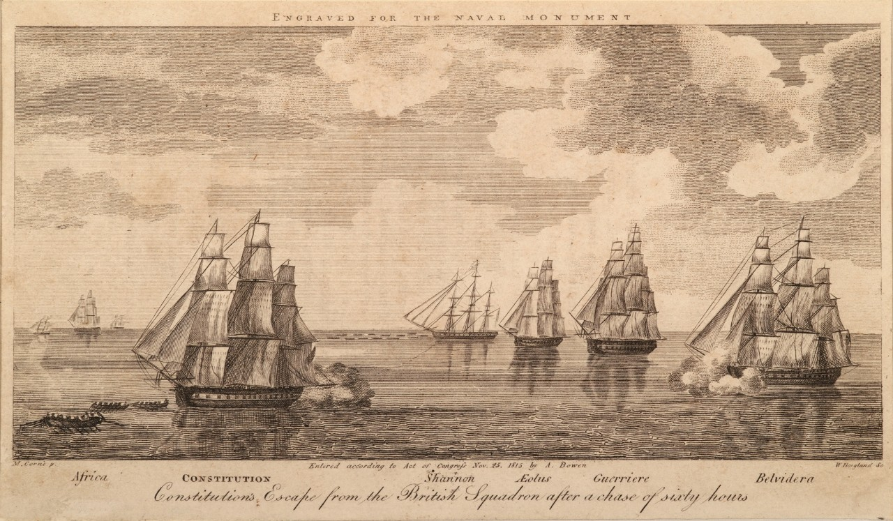 A fleet of the British flagged sailing ships are chasing a U.S. flagged ship being pulled by boats
