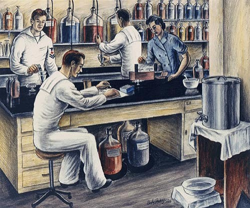 A WAVE and three enlisted men working at a lab bench