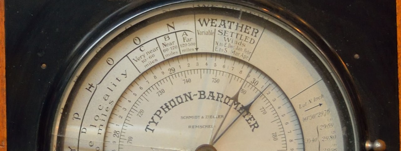 Typhoon Barometer with dials in a black case