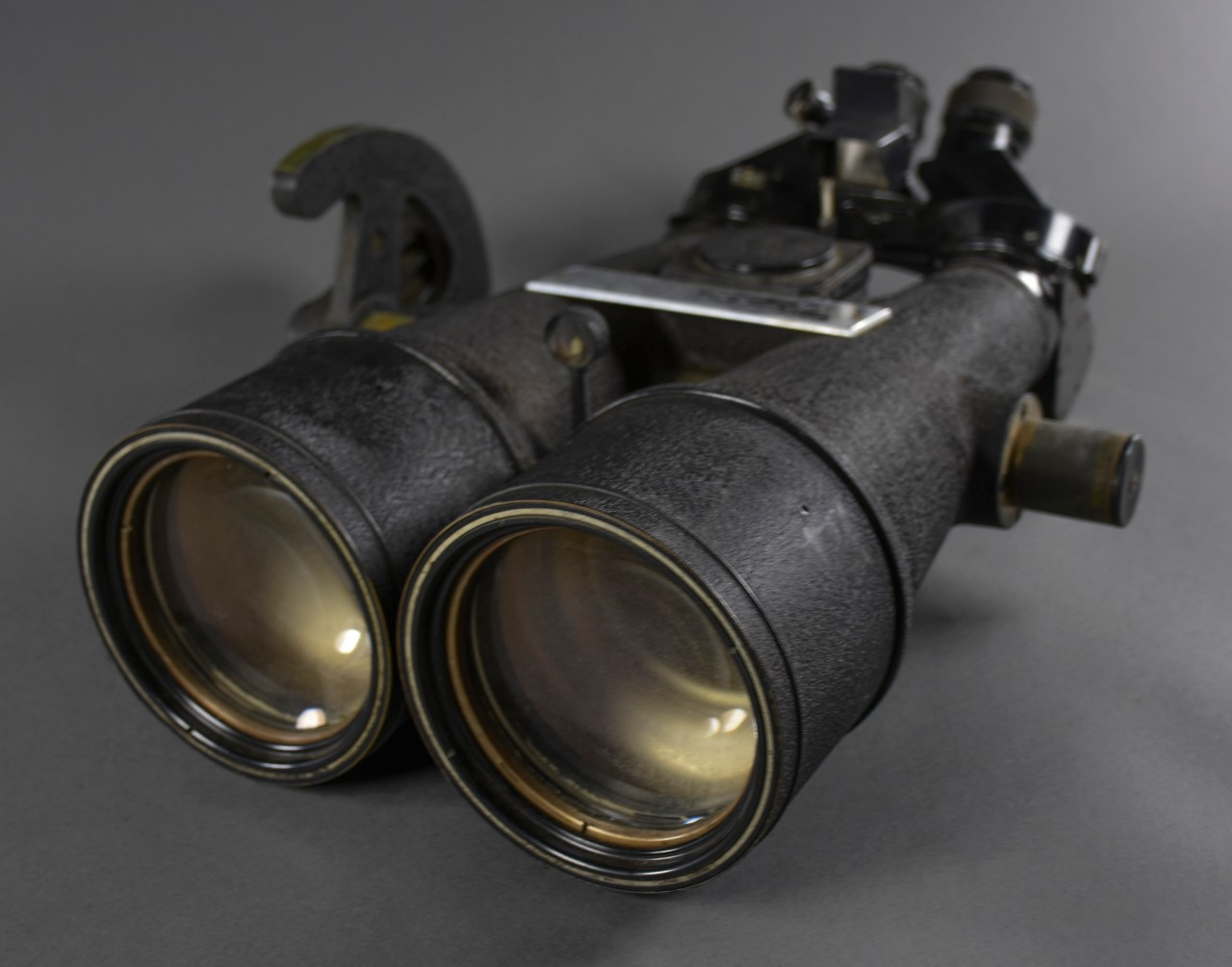 <p>Black Big Eye Binoculars with presentation plaque on top. Japanese characters on various sections of the binoculars&nbsp;</p>
