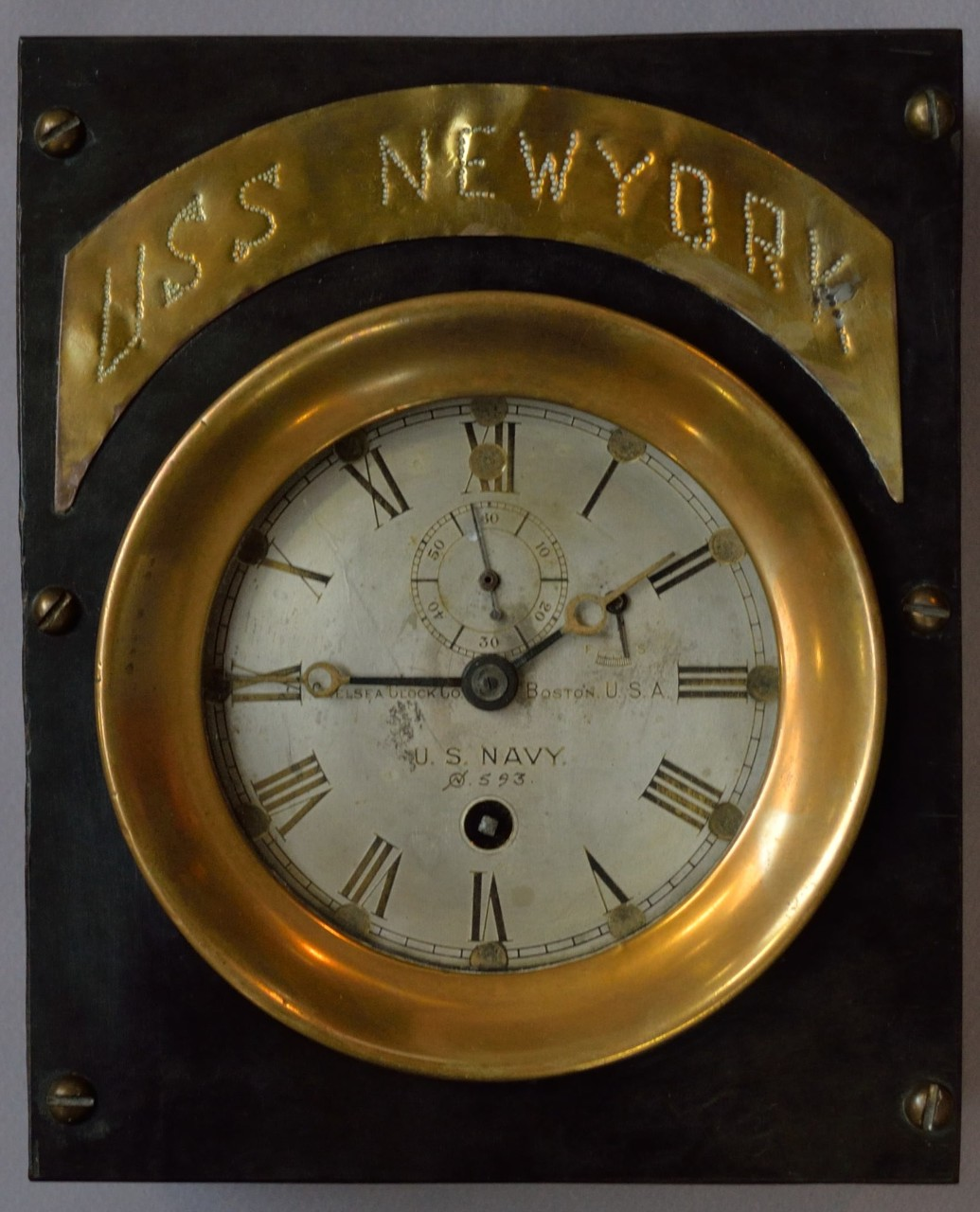 clock in black case with brass engraved USS New York Plaque
