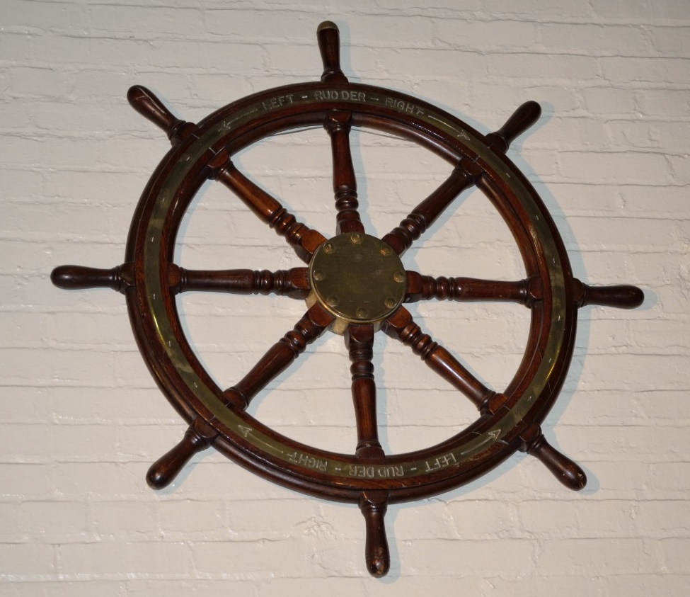 Eight spoked ship wheel with brass rim from the USS Pensacola
