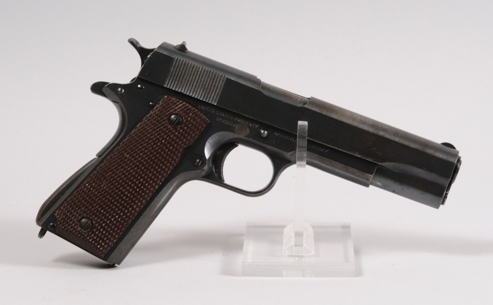 "<p>M1911A1 Pistol is recoil operated and semi-automatic; fed from a 7-round detachable box magazine contained in the grip. Fixed front and rear sights are mounted to the top of the full-length slide, which completely encloses the barrel. The pistol has a spur hammer and a frame spur to protect the firer's hand from ""hammer bite."" A grip safety is at the rear and a frame safety on the left side at the rear, behind the slide stop lever. The magazine catch release is also on the left, behind the trigger. The pistol is phosphate coated and has checkered brown plastic grips held on by two screws on each side. </p>"