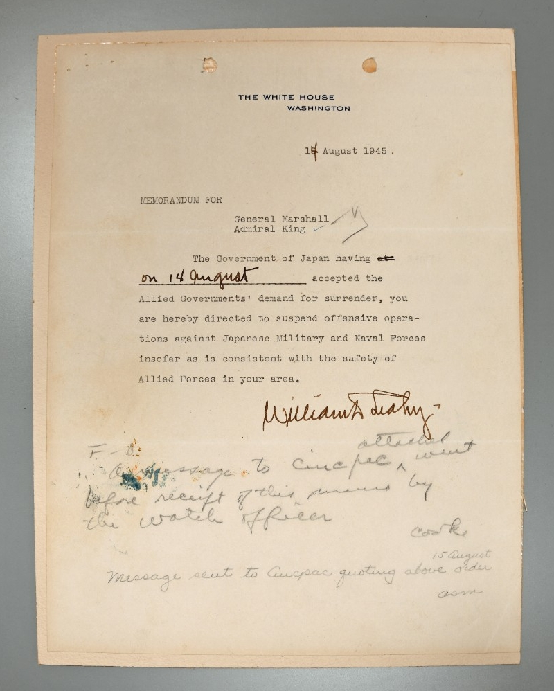 <p>Typed memorandum with handwritten notes concerning the suspension of offensive operations against Japan, signed by Fleet Admiral William Leahy.</p>