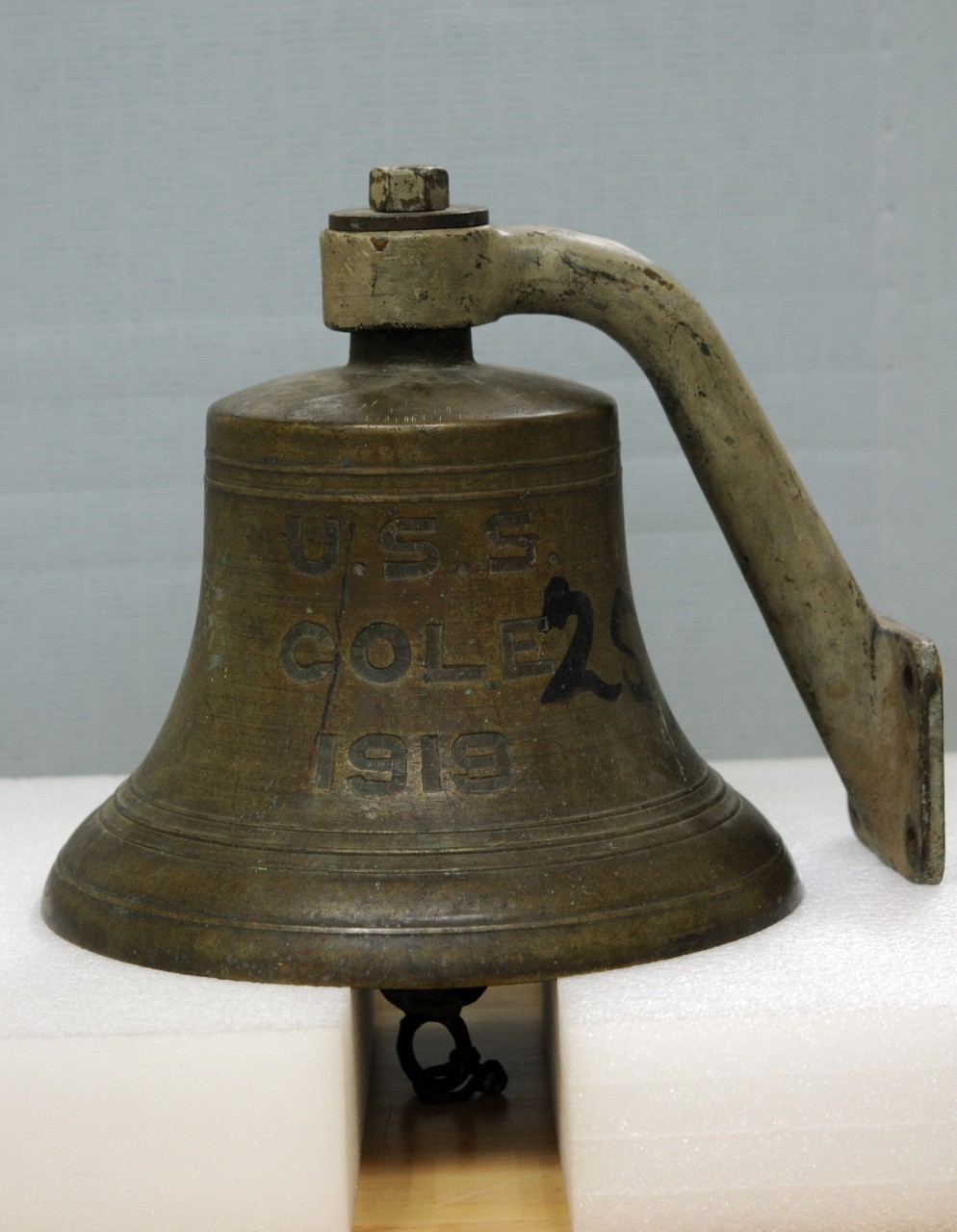One brass ship bell with USS Cole 1919 engraved into the bell